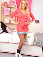 HM looks wonderful in a short denim mini with black sheer pantyhose.
