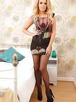 Porchia loooking stunning in this little minidress and black sheer tights.
