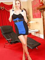 Delightful blonde Tindra relaxes in her tight minidress.